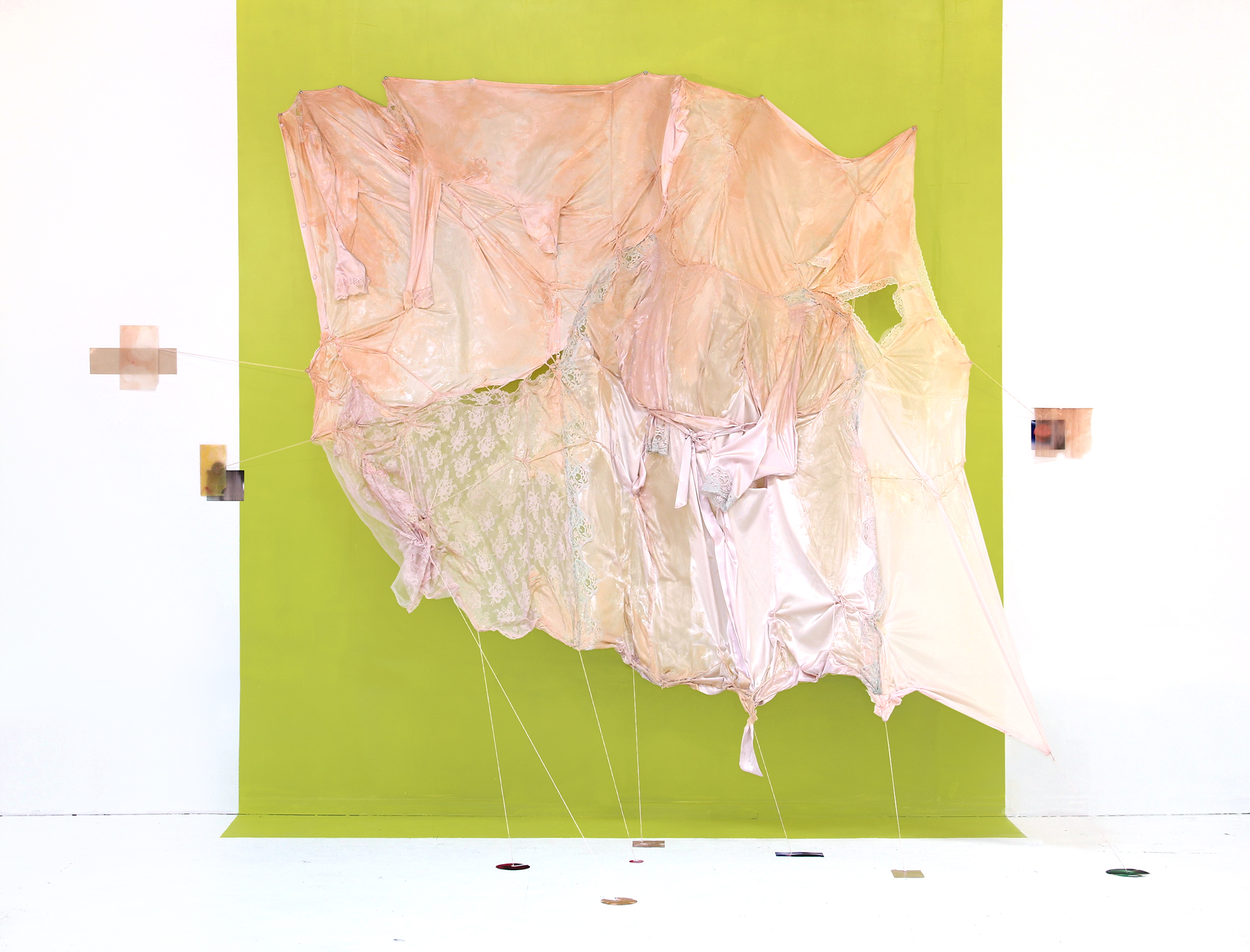 "Dermo-Graphic (Clusters), 2017 Fabric, thread, epoxy putty, inkjet prints, urethane rubber, acrylic on wall. 120""(W) x 52""(D) x 94""(H)"